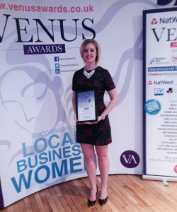 Kim the managing director accepting the award for local business woman award