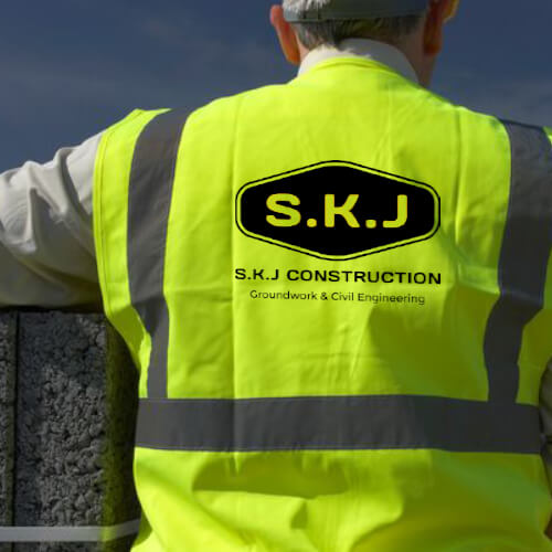 SKJ Construction logo on a hi visabilty vest worn by construction worker